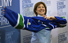 BC Premier Christy Clark dons Canucks jersey during 2013 election campaign (Andy Clark / Reuters)