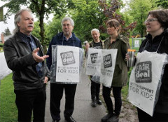B.C. Teachers Federation president Jim Iker (left) speaks to teachers during a work stoppage by teachers outside Charles Dickens Elementary in Vancouver on May 26, 2014. Photo by Wayne Leidenfrost, PNG