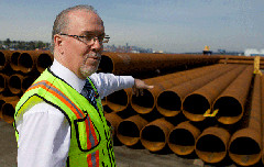 BCNDP Leader John Horgan touring Lynnterm docks in 2014 (BCNDP/Flickr cc licence)