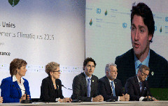 Justin Trudeau at the Paris climate talks, flanked by Canadian premiers (Province of BC/Flickr)