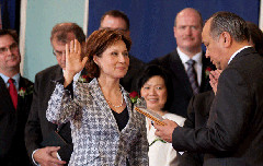 Christy Clark being sworn in as Premier of British Columbia in 2011, surrounded by her cabinet (Province of BC/Flickr)